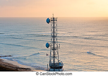 Communication Tower at sunset - A radio communications tower...