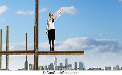 Businesswoman and cityscape - Business woman standing high...