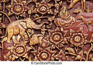 religious wooden carving detail of buddhist temple door,...