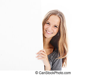 Smiling teenager with blank board - Smiling pretty young...