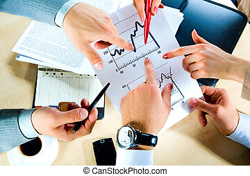 At workplace - Image of hands showing the document at...