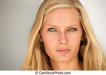 Beautiful young blond woman portrait.