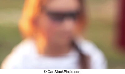 girl in glasses with a gun shooting