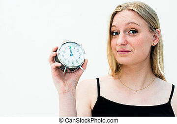 woman holding a clock - young beautiful woman holding a...