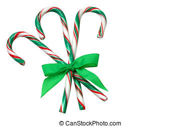 Candy Canes - Three candy canes, tied with ribbon, isolated...