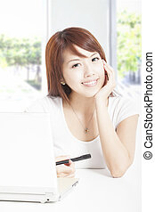 beautiful young woman with laptop in the office