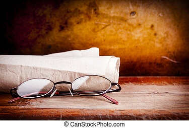 Old Glasses on Desk - Pair of old eyglasses on a wooden desk...