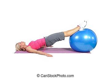 Fit young female pilates instructor showing different exercises on a white background
