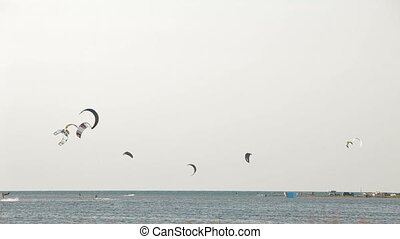 Extreme sport - People sailing in the sky on paragliders
