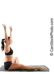 young woman in sports bra on yoga pose on isolated white...