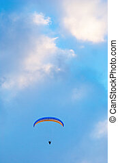 Hang glider - Hang gliding man on bright bue sky