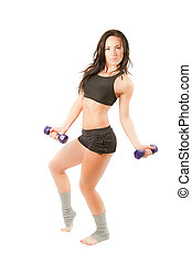 Young woman in sports bra workout in the gym with dumbbells...