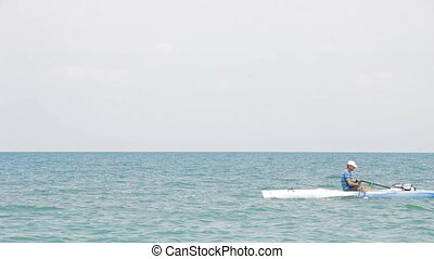Kayaking in the sea - A man kayaking in the sea on a sunny...