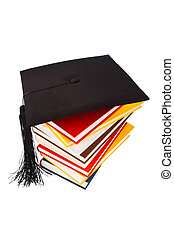 mortarboard on a book stack - a mortarboard on a book stack...