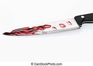 knife with blood. crime. a murder weapon - a knife smeared...