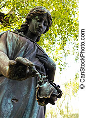 angel on a grave - an angel guarding a grave in a cemetery