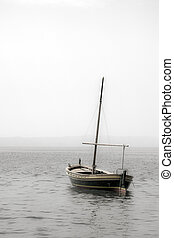 Fishing boat with a mast in sea - A photo of a small wooden...