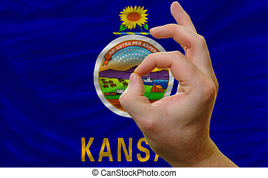 ok gesture in front of kansas us state flag
