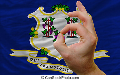 ok gesture in front of connecticut us state flag