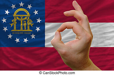 ok gesture in front of georgia us state flag