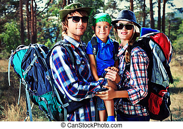 hiking family - Happy parents hiking with their little son