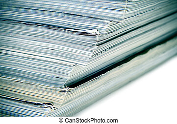 magazines - closeup of a pile of different magazines on a...