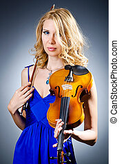 Woman with violin in studio