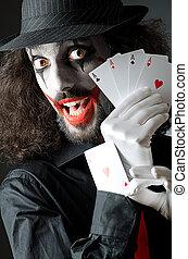 Joker with cards in studio shoot