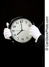 Time for work concept - Businessman holding a big clock....