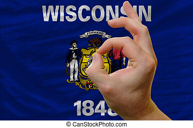 ok gesture in front of wisconsin us state flag - man showing...