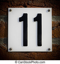 Number 11 - house number eleven embossed in a white metal...