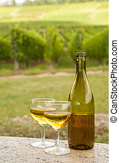 Bottle of Alsace wine - Bottle and glasses of white Pinot...