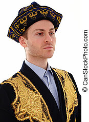 Young handsome man in typical Kazak dress