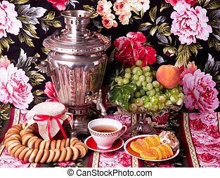 traditional old Russian tea kettle with bagels and...