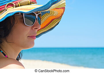 Woman wearing sunglasses and hat - Closeup portrait of a...