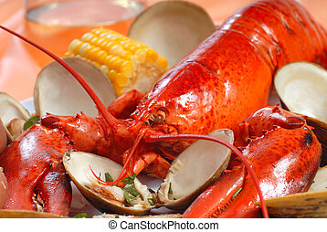 Boiled lobster dinner with clams and corn - Delicious boiled...
