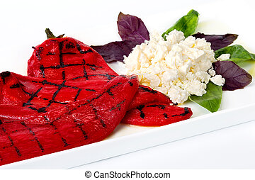 A dish of grilled red pepper and cheese - Roasted red bell...