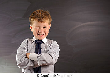 Cute boy against blackboard - Cute preschooler against dark...