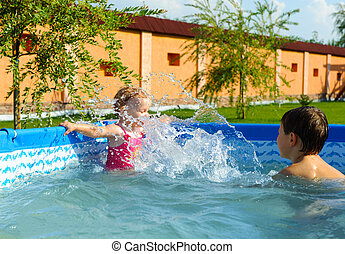 Brother and sister in swimming pool