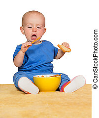 Little baby eating biscuits - Cute little baby sitting on a...
