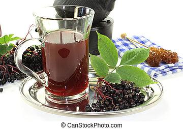 elderberry tea - a glass of elderberry tea with fresh...