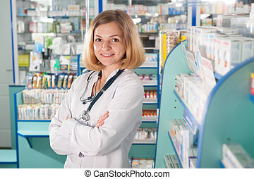 Young pharmacist in drugstore