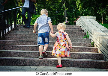 Walking in park - Brother aged four and sister aged two...