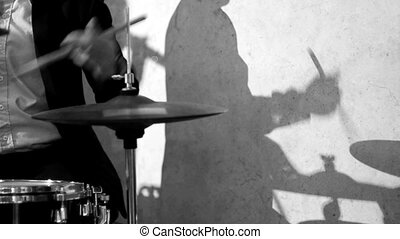 Drummer and Shadow - Drummer Playing and Shadow in Black and...