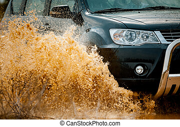 suv splash on the river outdoor ,traveling on the road.
