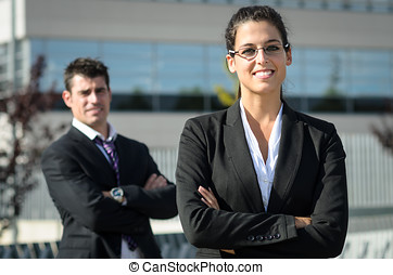 Happy business people - Idly business people smiling with...