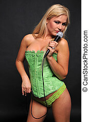 Blonde - Beautiful blonde singing in lime green bustier and...