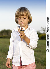 Young boy eating a tasty ice cream