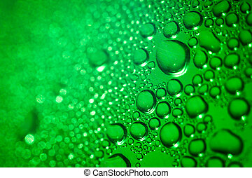 Refreshing green watery background color toned image;...