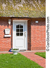 Suburban home front porch - Close-up of the main entrance of...